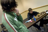 DM1858   Josh Divine, 17, left, of Colorado Springs steps away from the table as he plays Tyler...
