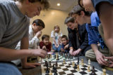 DM1866   Players at the Colorado State Scholastic Chess Championship gather round to play...