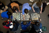 DM1867   Players at the Colorado State Scholastic Chess Championship gather round to play...