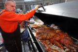 A BBQ Pork roast was prepared, complete with the letters RTD branded on the skin of the pig, as...