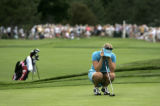 Morgan Pressel hangs her head after she chipped over the green on the 8th hole on the first day of...