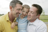 Three year old Joey shares a hug with his daddy Dave Johnson (cq) (left) and his papa James Lyman...