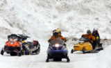 Search and rescue teams headed out to find 4 lost snowmobilers Monday morning Frbruary 11,2008. ...