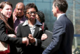 Rhonda Fields, center, mother of Javad Marshall-Fields, speaks with her personal attorneys Sheri ,...