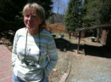 Jan Ziman stands out front of her home along Fall River Road in Idaho Springs April 23, 2008...