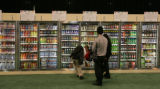 Vendors learn how to display the drinks for 7-11 at their Traveling Food Show at Colorado...