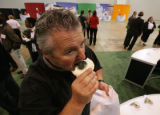Mark Miller takes a bite of his 'hulk cookie' at the 7-11 Traveling Food Show at Colorado...