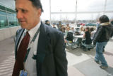 BG0180 Frank DeAngelis, Principal of Columbine High School keeps watch over students during a...