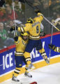 DM1948   Michigan's Aaron Palushaj leaps into the arms of teammate Matt Rust after Rust scored the...
