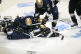 DM2535   The Notre Dame Fighting Irish pile on top of their teammate Calle Ridderwall after his...