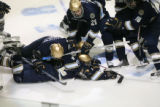 DM2536   The Notre Dame Fighting Irish pile on top of their teammate Calle Ridderwall after his...