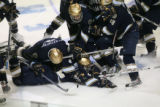 DM2537   The Notre Dame Fighting Irish pile on top of their teammate Calle Ridderwall after his...