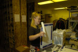 Sarah Given (cq) works on getting out packages Thursday morning June 9, 2005 for Mr. Haney's,...