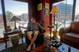 Jeff Attridge, 51, CQ,  a retired businessman, enjoys a Camacho cigar across from the new...