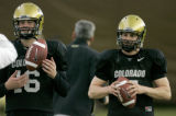BG0472 Matt Ballenger, left, a back-up quarterback for the University of Colorado is giving Cody...