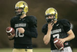 BG0498 Matt Ballenger, left, a back-up quarterback for the University of Colorado is giving Cody...