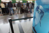 Passengers check in at the Frontier Airlines ticket counter at DIA Wednesday April 11, 2008....