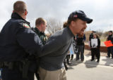 Photo by Gretel Daugherty -- Officers arrest Jacob Richards of A Voice of Reason for obstructing a...