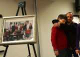 Good Samaritans Andrew Rosenberg (cq), right, hugs Zenith Tilleman-Dick (cq)(son of Timber Dick),...