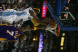Carmelo Anthony (cq) is stuffed by the rim as Lamar Odom (cq) defends. The Denver Nuggets returned...