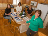 (Arvada, Colorado, April 11, 2008) House-staging team Amy Tennal, Donna Ward, Vicki Weller, and...