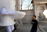(PG0406) Lester Kemp, 12, interacts with someone dressed as a running toilet. People browse...