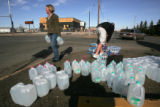Sales reps with Yellow Book USA give away water on HWY 160  in Alamosa Wednesday morning March 26,...