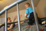 MJM384  Tanya Strickland (cq) plays with friend's son, Oakley McCarver, 3, left, Wednesday...