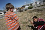 MJM722 Phoenix Lizotte, 4, left, plays guns with neighbor, Edwardo Herrera (cq), 11, right,...