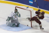 DM0931   Boston College forward Nathan Gerbe skates past a stunned North Dakota goalie...