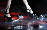 A dancer at the Penthouse, dances through a pile of cash during her performance at the Penthouse...