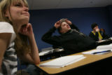 MJM213 Katie Manson (cq), 20, left, and Dan Sage (cq), 20, center, listen to their instructor,...