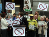 Sen. Dan Gibbs (cq) D-Silverthorne,gets the crowd to yell no to tolls  during a protest against...