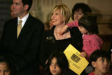 3 year-old Brissa Reyes (cq) is held by State Representative Buffy McFadden (cq) during a press...