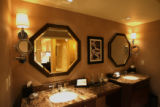 Twin sinks and mirrors are part of the restroom, in the Ritz -Carlton Suite, Thursday morning,...