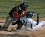 Alex Knoll, ThunderRidge, it tag out at home by Rocky Mountain catcher Nic Wunsch, in the bottom...