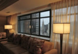 Large windows give views of downtown Denver, in the Ritz -Carlton Suite, Thursday morning, March...