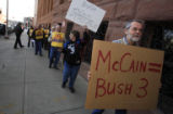 "DM0070   ""No more McSame"" chants a crowd of a couple dozen protesters as Steve Brown of..."