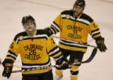 [ JOE0479 ] Colorado College Scott McCulloch (26) and Tyler Johnson skate to the bench after the...
