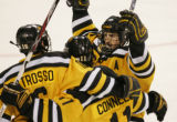 [ JOE0773 ] Colorado College's Derek Patrosso, left, celebrates his goal with Brian Connelly, and...