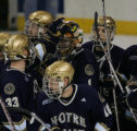 [ JOE0592 ]  Notre Dame goalie Jordan Pearce (1) is congratulated by teammates after the Irish...
