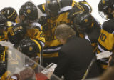 [ JOE0676 ] Colorado College coach Scott Owens diagrams a play late in the third period of CC's...