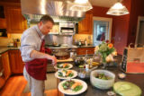 Pete Marczyk makes dinner at his house--with fresh salmon, green beans, lettuce and eggs from his...