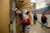 DM0490   A dancer with the Tlaloc Aztec Dance Group dips his head to get his headdress through the...