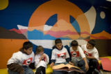 DM0732   Students from Escuela Bilingue Pioneer Elementary gather together to read...
