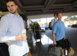 Denver Nuggets player Linas Kleiza (left) waits with assistant coach John Welch for a cab outside...