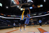 Denver Nuggets player Yakhouba Diawara (left) and Taurean Green practice at the US Airways Center...