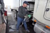 Doug Bertella (cq), 49, fuels up his 18 wheeler at the Sapp Bros. truck stop in Commerce City...