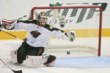 DM2285 Minnesota's Niklas Backstrom makes a save in the second period as the Avalanche host the...