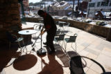 Employee James Robinson (cq) keeps the smoking patio spotless at Ameristar Casino in Black Hawk...